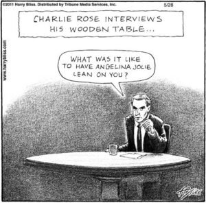 Charlie Rose interviews his wooden table